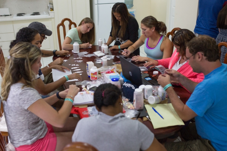 Volunteers and registered nurses working with the non-profit organization, Worthy Village, prepare supplies for health clinics in rural villages of Guatemala around Lake Atitlan.
